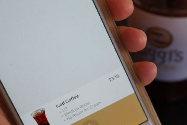 Picture of person using the Ziggi's Coffee voice ordering mobile app